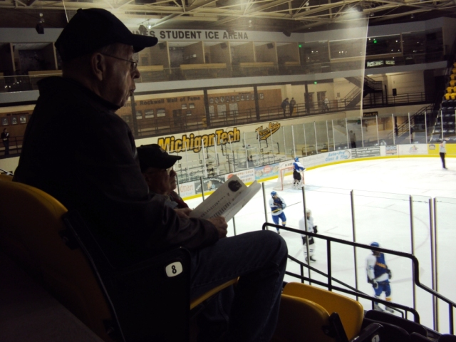 Hockey spectator in stands