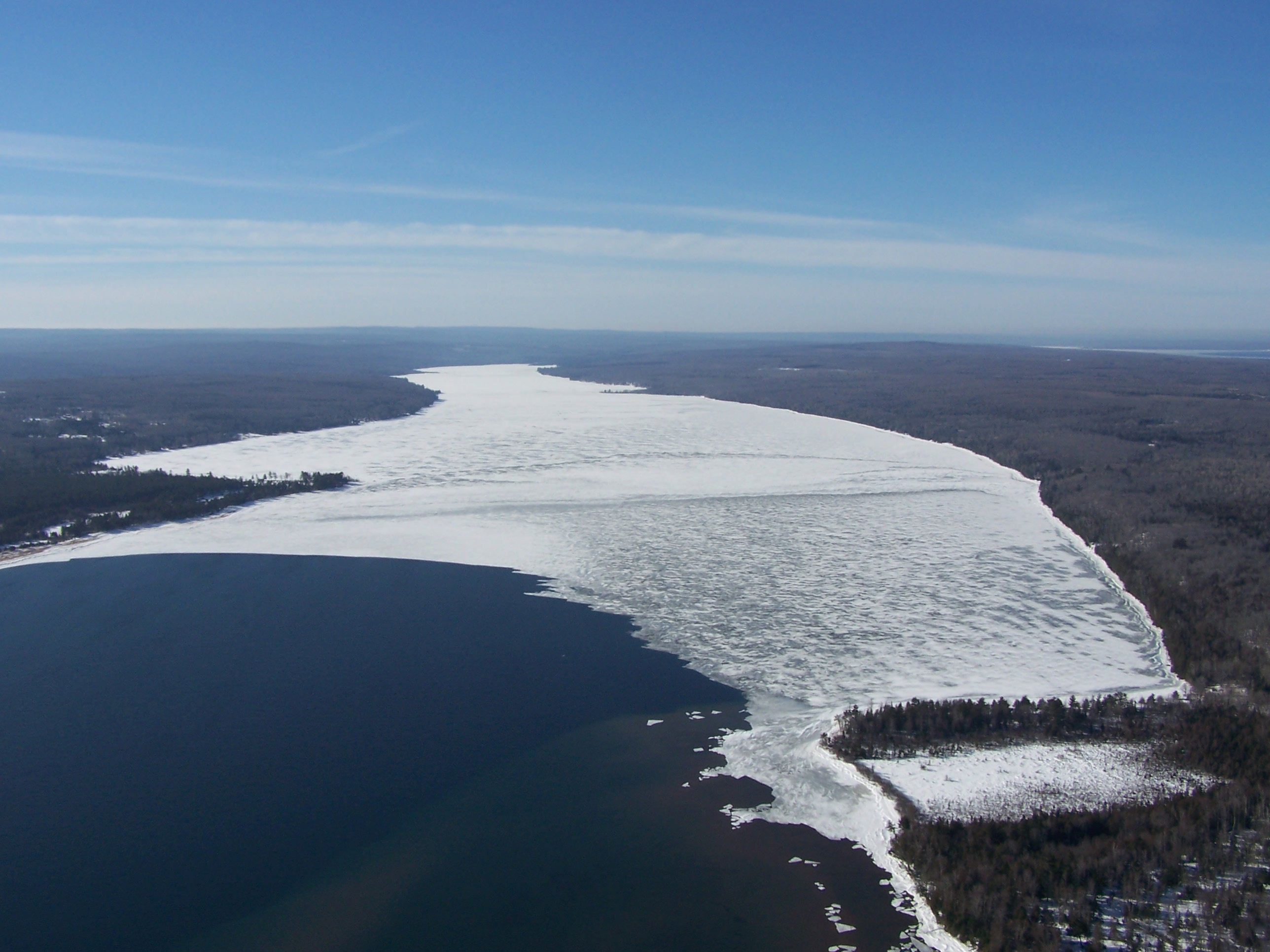 An eagle eye view of lake superior in mid winter lake for Lake superior ice fishing