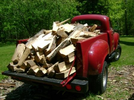 OK, OK, you want to see a pic of the '49 Stude, do you?  Here it is, filled with wood.  It's a wood-haulin' truck, you know.