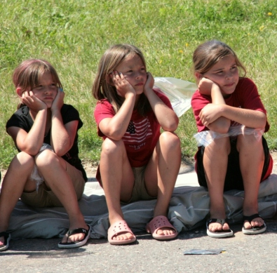 Friends listening to fire trucks at a parade