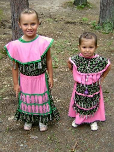 Little girls in Pow Wow dresses
