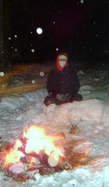 Daughter sitting by Solstice fire, December, 2008