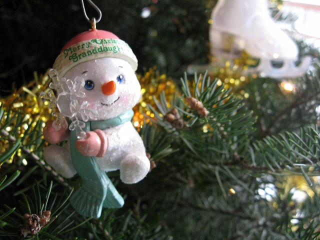 This little snowman just hangs on the tree and watches the tomfoolery of the Others.