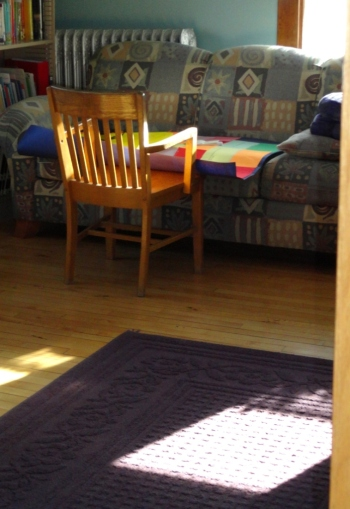 Old wooden chair in the library.  Light streaming through the windows.  Peaceful morning during Easter break...