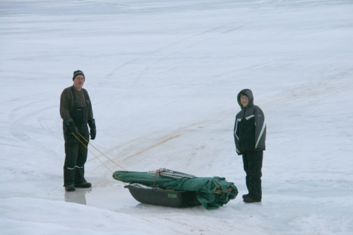 Barry and Derrick prepare to pull the ice fishing tent out on the Keweenaw Bay