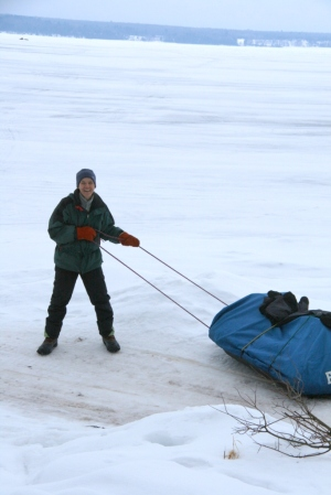 Nancy prepares to pull her sled out on the ice