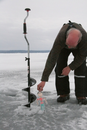 Barry instructs Flat Stanley all about ice augers and fishing holes