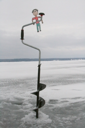 Flat Stanley drills a hole with the ice auger