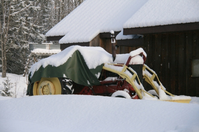 Note the snow bank obscuring the view of the tractor.
