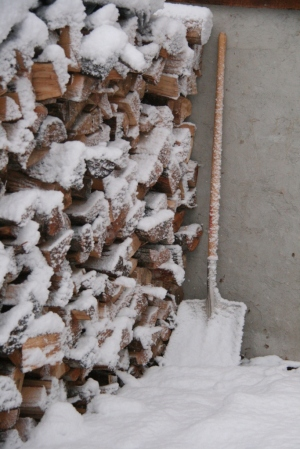 Wood pile.  Snow shovel.