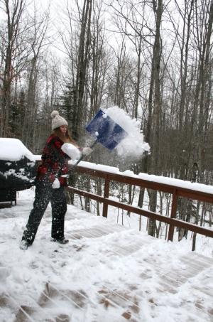 December, 2012.  Our daughter helps shovel the deck.