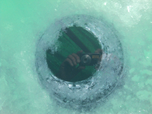An ice fishing hole