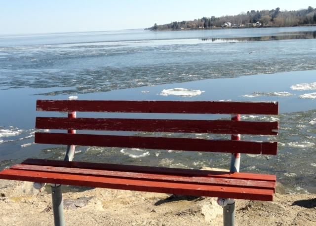 Red bench before yonder breaking ice