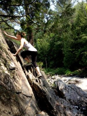 Daughter doing a little river rock climbing