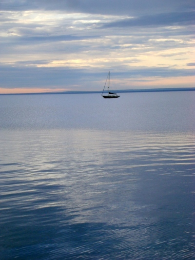 Calm seas.  Sailboat.