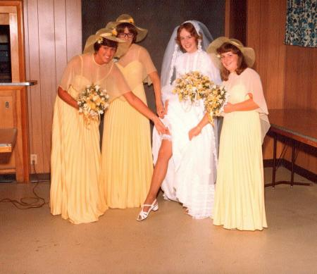 "The bridesmaids wore yellow. The photographer said, ""Show a little garter."""