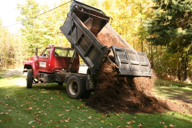 Dump truck delivers our pile of manure for the garden!