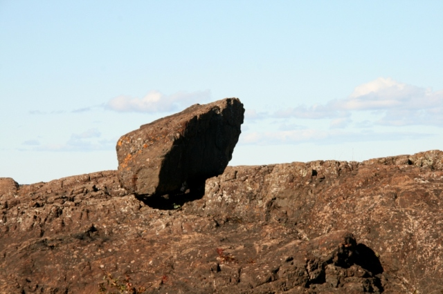 Jutting rock.  He contemplates the jumpers.