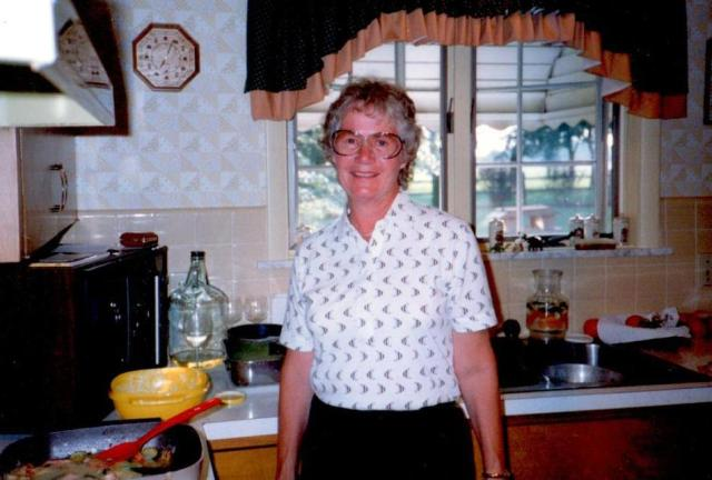 Mom in her beloved kitchen in 1989
