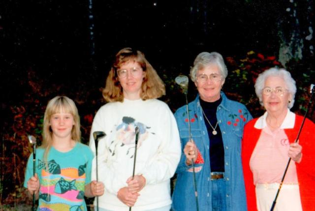 Four generations of golfers.  (Ha ha, one of the FEW times I've held a golf club in hand!)