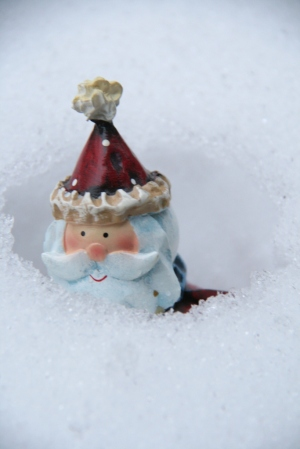 Santa almost buried in snow