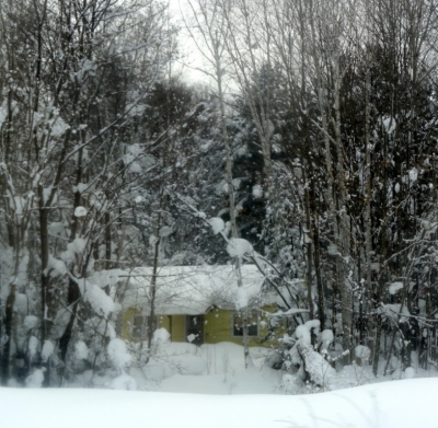 Another Little House in the Big Woods between Houghton and L'Anse.  Through car window.