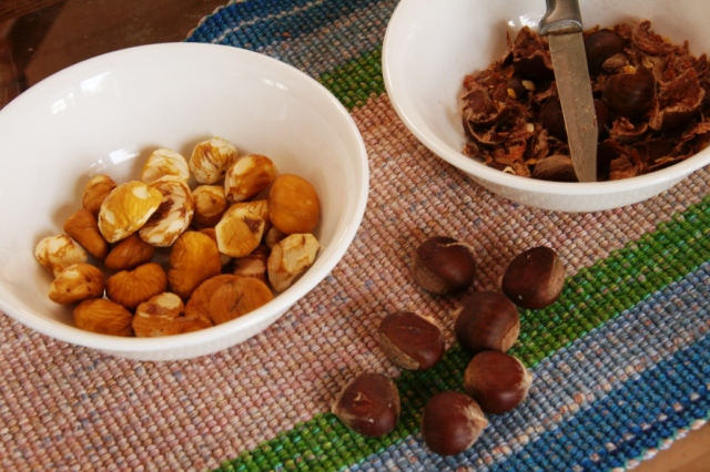 Brown chestnuts with shells, peeled chestnuts, shells