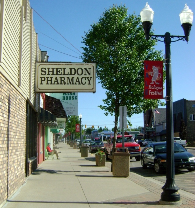 Calm, peaceful Main Street in Yale, MI, in 2009.  My dad sits on that bench waiting for me with a cappuccino.