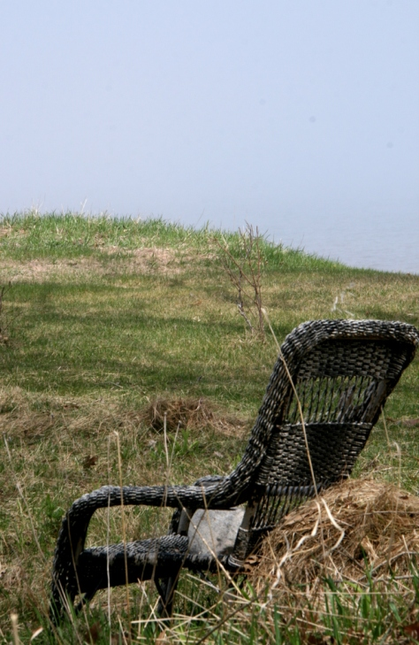 Wicker chair on bluff overlooking lake