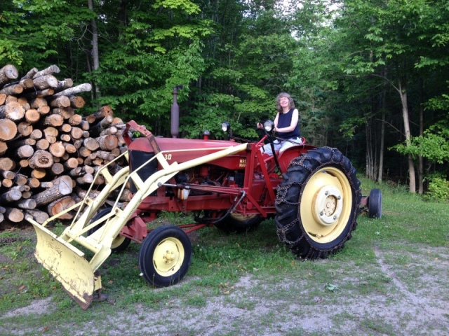 Me on the tractor pulling the wood splitter. If you squint you can see that I'm pulling the aforementioned splitter.