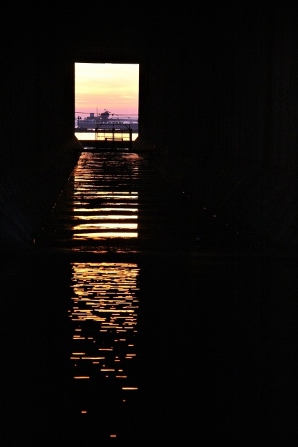 """Close-up of the freighter through the """"eye"""" of the ore dock"""