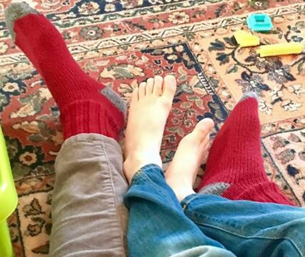 Pam's red feet--and her grandchild's bare feet