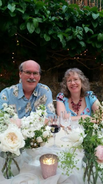 Close-up of us.  Don't we look Hawaiian with our wedding attire?