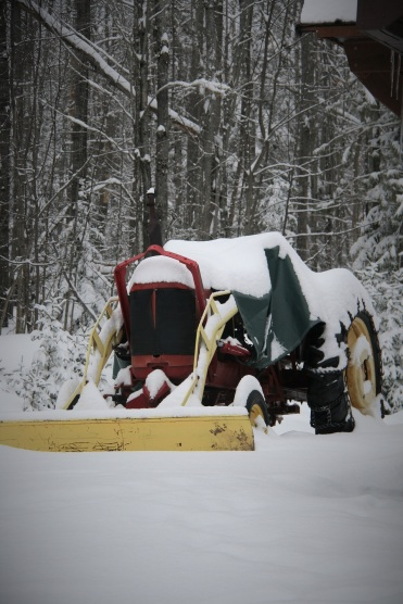 Tractor which will plow the driveway when husband returns from work
