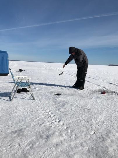 My husband catching a fish on Lake Superior