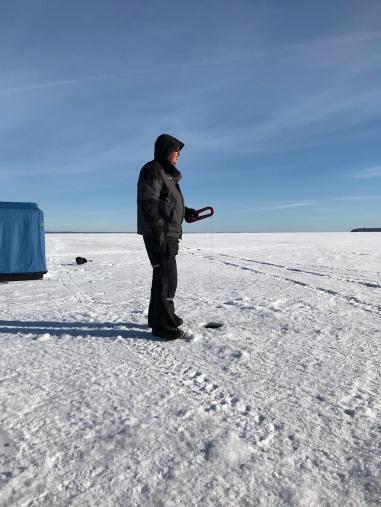 My husband ice fishing on Lake Superior