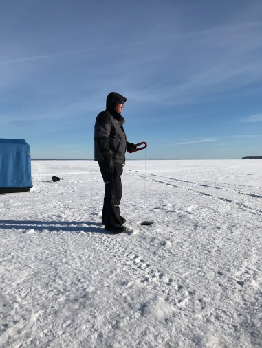 My husband ice fishing on Lake Superior