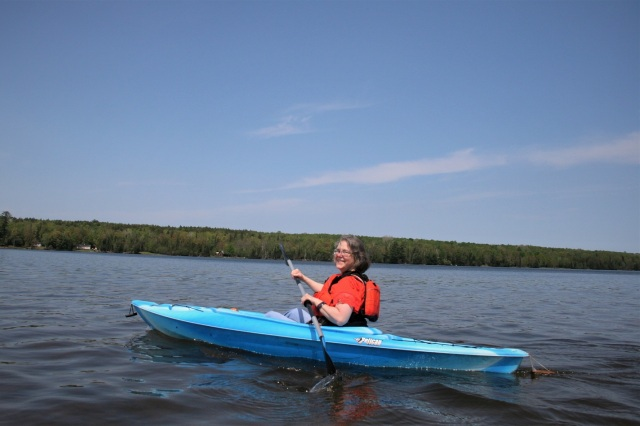 Sherry...blithely kayaking...not yet aware of the snake accompanying her...