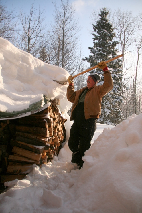 Pretty close to March, 2014.  Shoveling off the wood pile--before we built the wood shed.