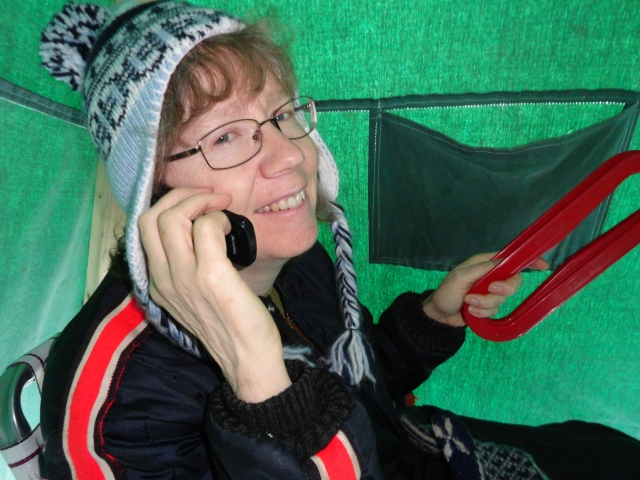 Talkin' on the cell to Florida while fishing in the ice tent, March 2013